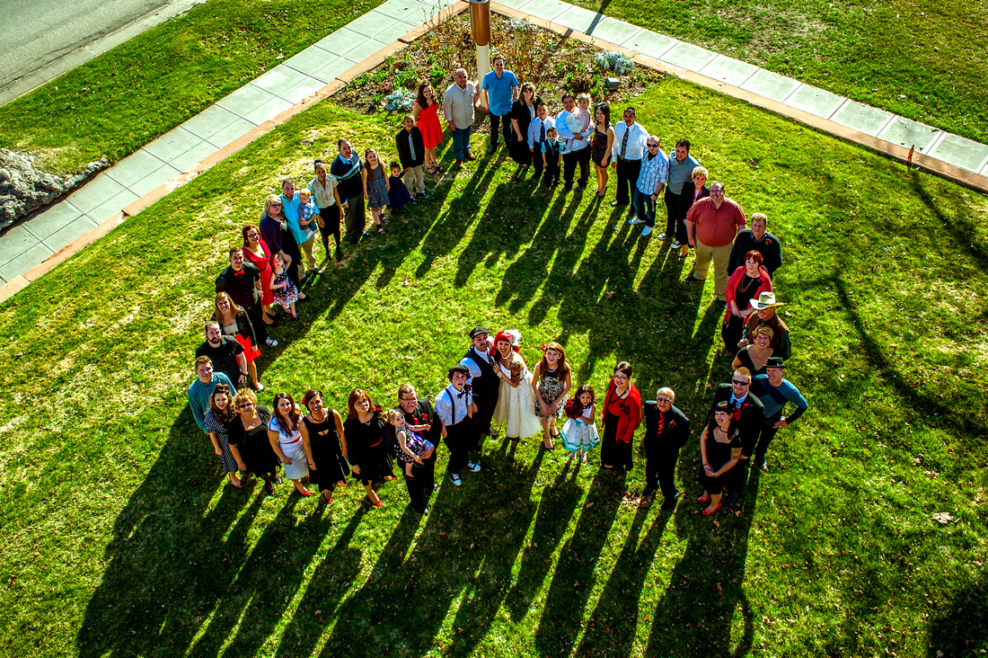 Big group family picture from above in the shape of a heart.
