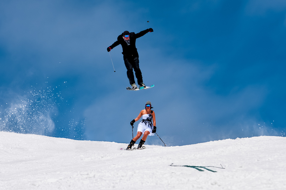 Groom Jumps over his bride on the ski slopes of Park City.