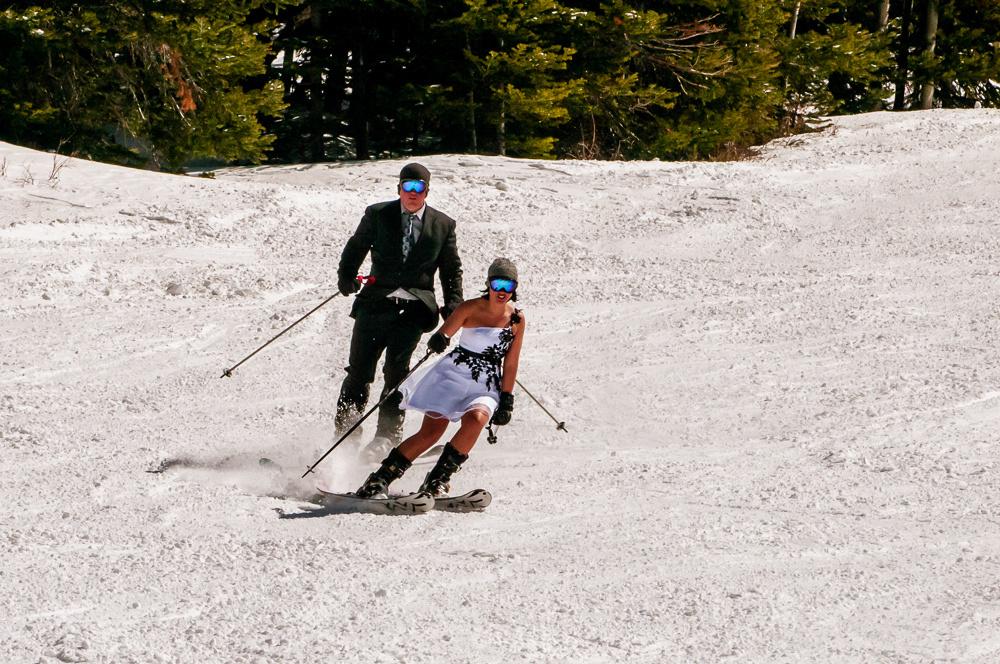 Bride and groom ski together