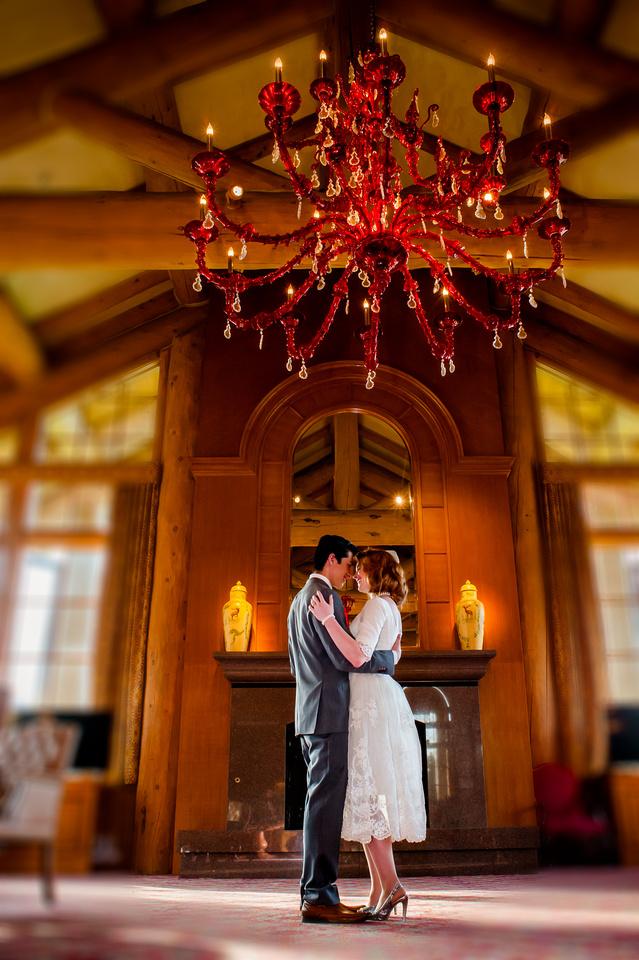 Snowbasin Wedding Inspiration-Bride and groom dance under Murano chandelier in the Earl's lodge, Snowbasin.
