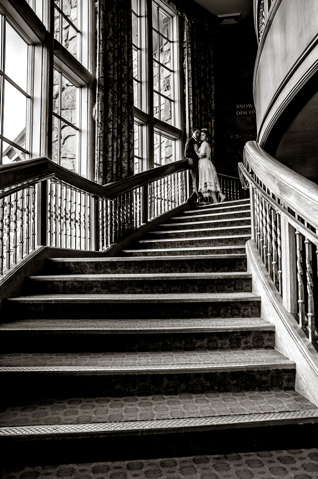 Snowbasin Wedding Inspiration-Bride and groom pose on beautiful staircase.