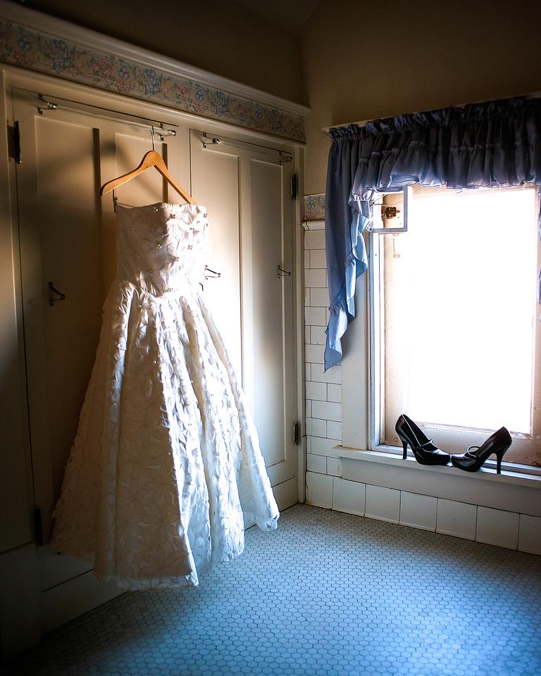 Vintage wedding dress shot in antique bathroom, high heels included.