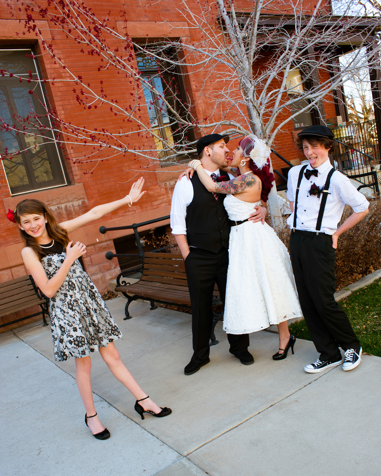 Kids act grossed out by mom and dad kissing at wedding in Ogden, Utah