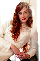 Vintage red head bride on a piano back lit with natural window light.