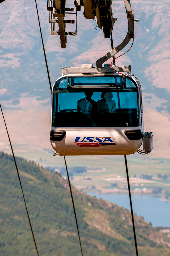 Bride and groom ride gondola to their ceremony in the needles lodge, Snowbasin, Utah