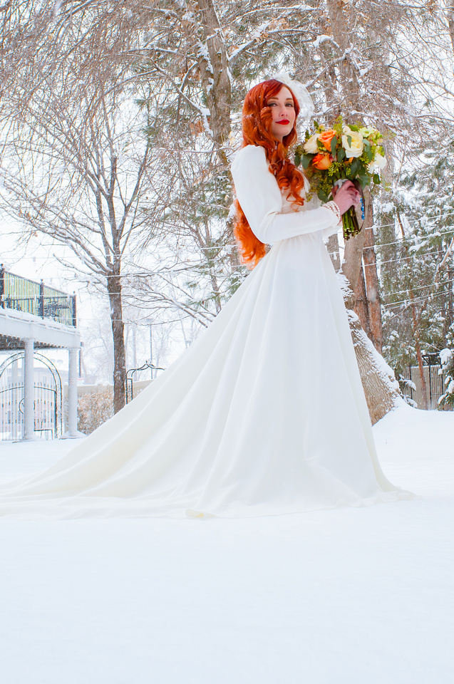 Stunning red hair on a fair skinned bride in the snow at the Woods on Ninth, Utah