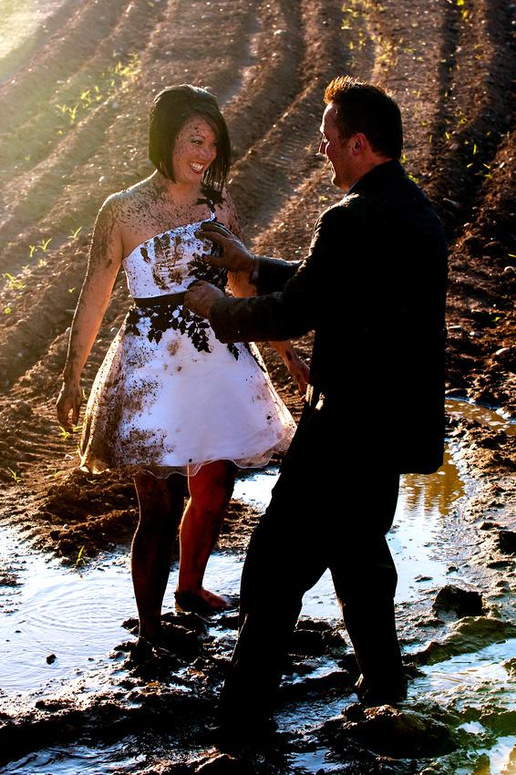 Groom leaves muddy hand print on bride's dress