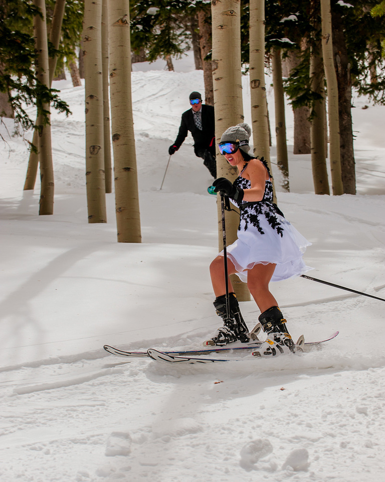 Bride and groom skiing in the trees