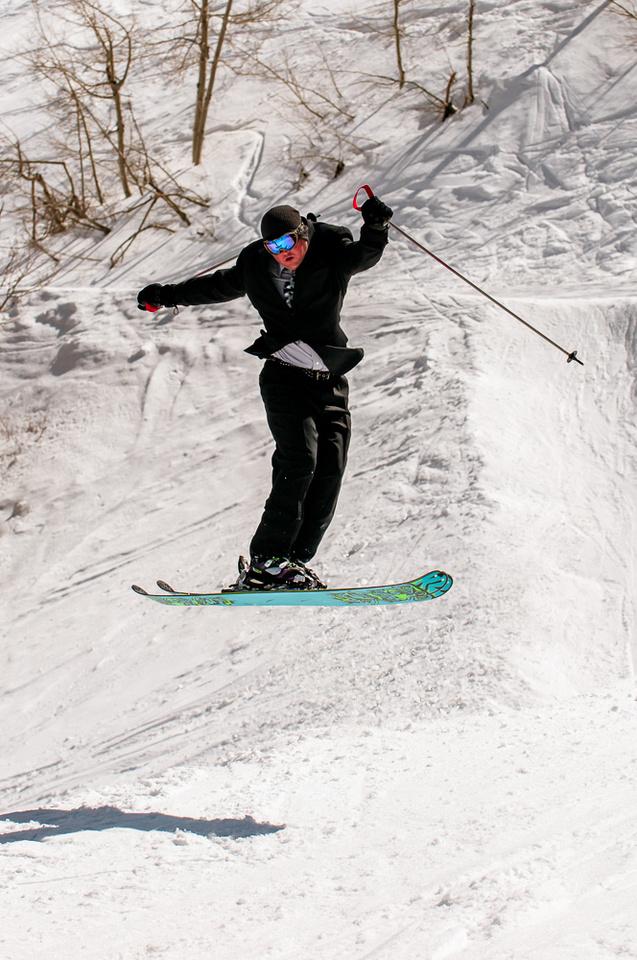 Groom on k2 pow skis mid air
