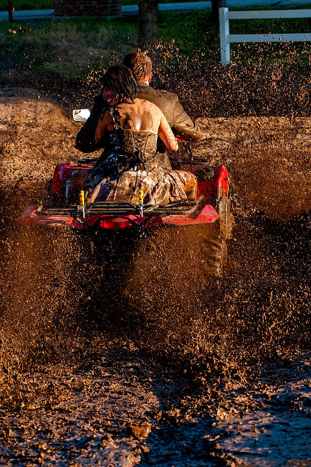 Bride and Groom drive 4 wheeler through mud