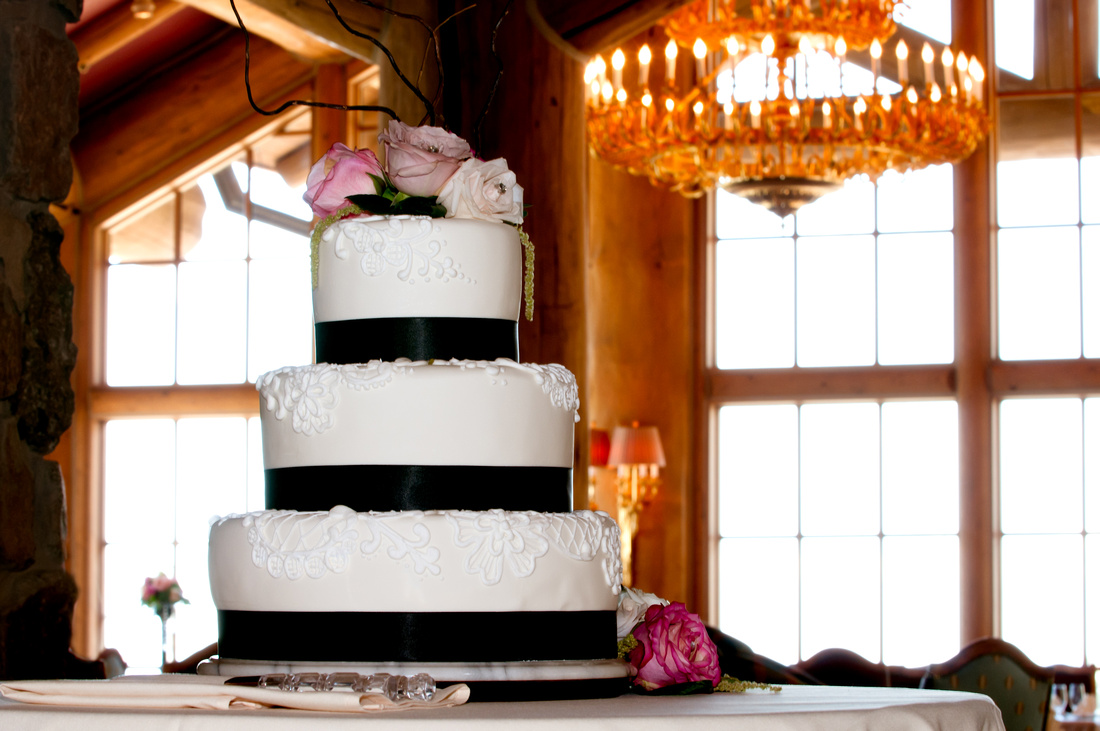 Snowbasin Wedding Inspiration-Wedding cake with chandelier in background