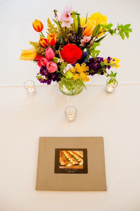 Floral arrangement with candles and book