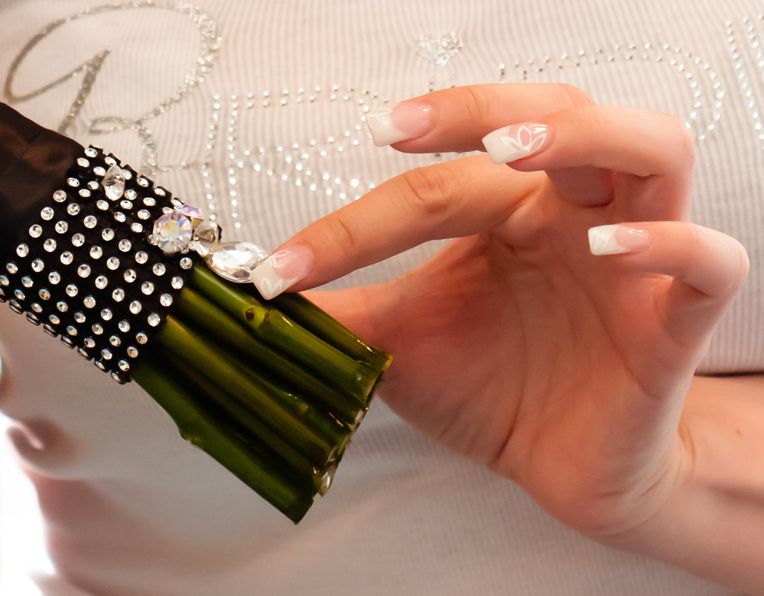 Close up detail shot of bride's nails, bride getting ready shirt and bling on her bouquet
