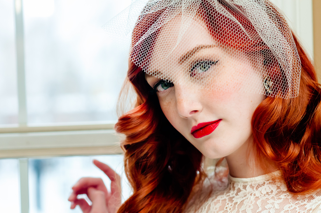 40's inspired red hair, makeup and veil on a stunning bride. Red Scarlet Makeup Artistry