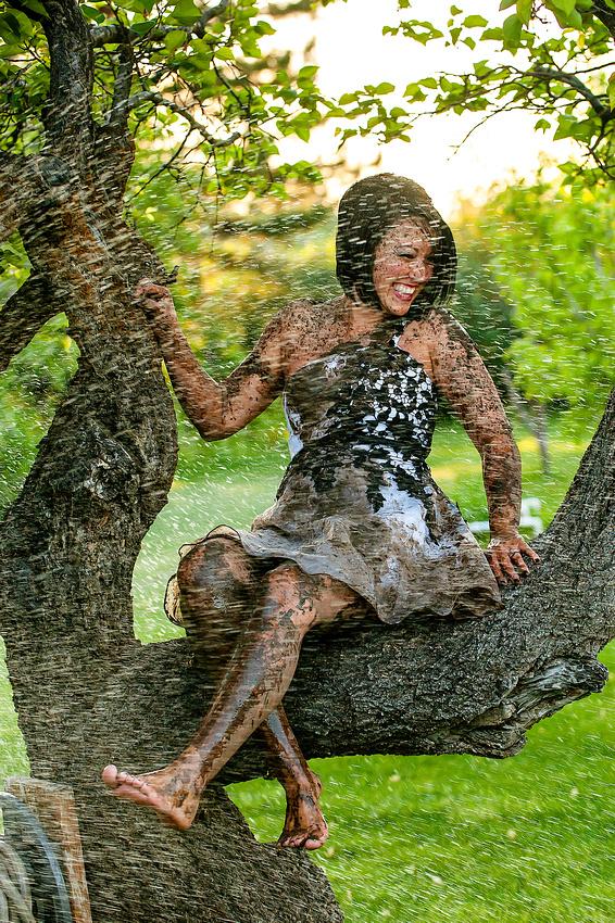 Muddy bride gets the hose