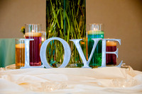 Love, wedding candles and vase